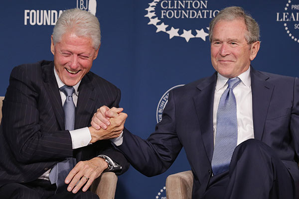 WASHINGTON, DC - SEPTEMBER 08:  Former U.S. presidents Bill Clinton (L) and George W. Bush talk about their hopes for the Presidential Leadership Scholars program at the Newseum September 8, 2014 in Washington, DC.With the cooperation of the Clinton, Bush, Lyndon B. Johnson and George H. W. Bush presidential libraries and foundations, the new scholarship program will provide 'motivated leaders across all sectors an opportunity to study presidential leadership and decision making and learn from key administration officials, practitioners and leading academics.'  (Photo by Chip Somodevilla/Getty Images)